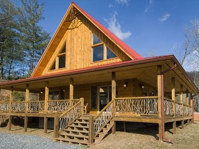 Cabin is pointed to best view!  Laurel custom hand rails adorn inside and out.