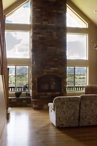 View out living room and fireplace.