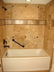 Even the Guest bath has a travertine marble tile surround and safety bars!