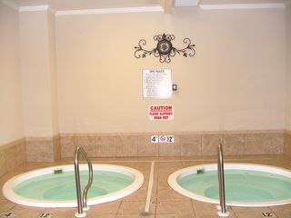 Fort Morgan condo photo - Indoor and Outdoor Hot Tubs are available to you!