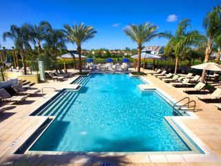 Runaway Beach Resort condo photo - South Beach themed adult pool and hot tub area