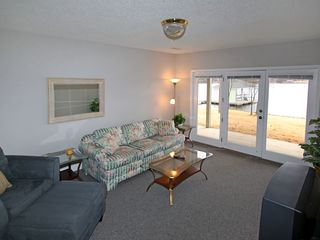 Moneta house photo - Downstairs seating area with direct access to lake