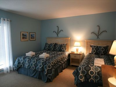 3rd bedroom has queen and twin beds and attached bathroom.