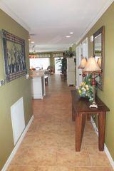Pensacola Beach condo photo - Hallway leading to kitchen, dining room and family room