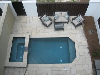 Inlet Beach townhome photo - Courtyard, private pool, rear gate and stone walkway. 1 minute walk to beach