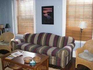 Frankfort lodge photo - The Manitou living room features comfortable chairs, plus a queen sofa bed.