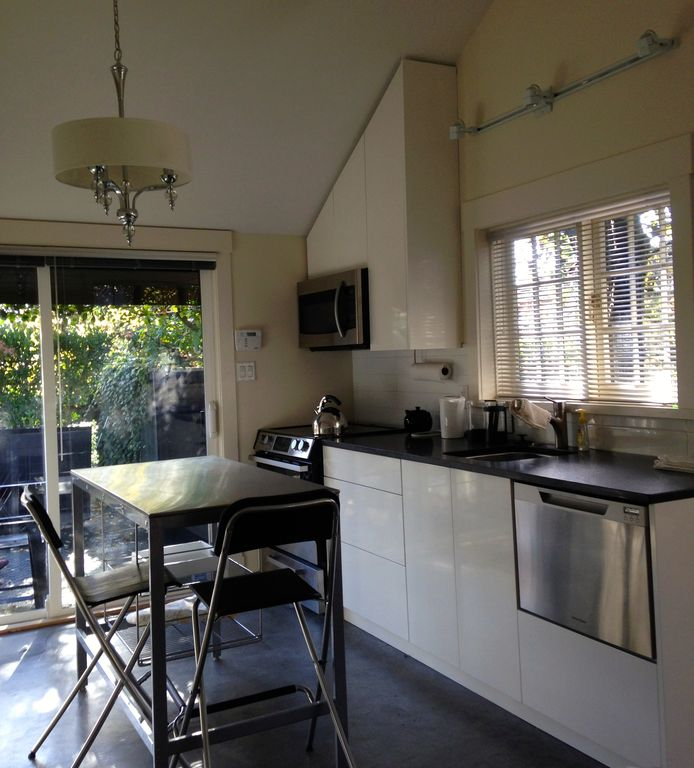 Brand new fully equipped cottage with private patio and parking.
