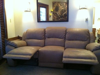 Comfortable Leather Sofa with Dual Recliners. Ottoman Converts into Gaming Chair
