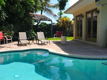 Oakland Park house rental - Relax and get a tan by the pool in the tropical backyard!