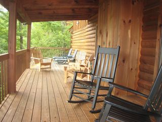Gatlinburg cabin photo - Sit in the rockers on the covered deck.