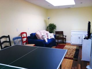 Game Room with Sofa Bed, Dart Board, Flat Screen game console and Table Tennis.