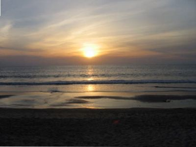 Fabulous sunsets on 20 miles of walkable swimable beach--50 feet from your door