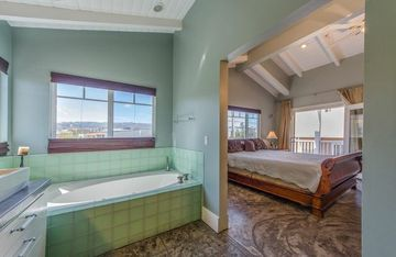 View of master bedroom & private deck from bath