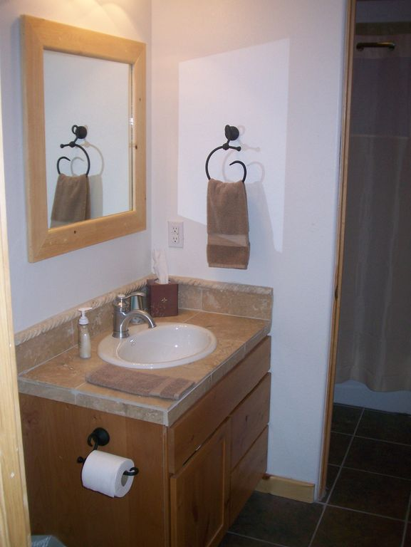 Two half baths connect to shower and tub ...