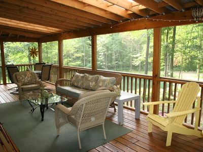 Deck with living area overlooking pond