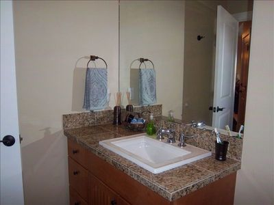 Luxurious bath with granite counter tops and plush towels.
