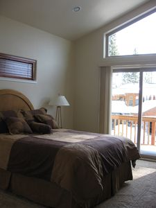 Upstairs King bedroom with deck & beautiful views