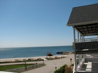 View of the beach from the covered porch