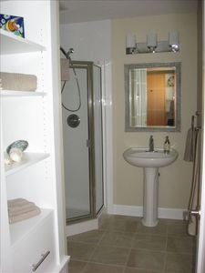 Bathroom: Tiled floor (heated), toilet, shower and pedestal sink