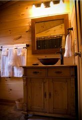 Stanardsville cabin photo - 2d level full bath; copper sink, antique dresser, queen & twin BRs adjacent.