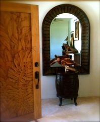 Kihei house photo - Hand Carved Door & Sea Turtle Welcome You At Entry/Travertine Flooring