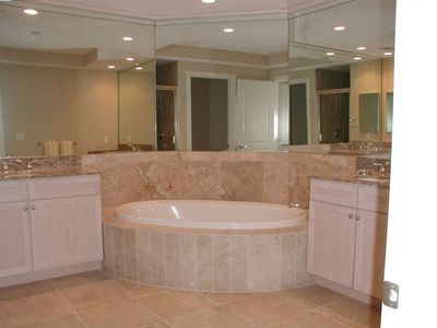 Master bath with jacuzzi and walk in shower