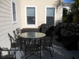 Plenty of patio seating - Isle of Palms house vacation rental photo