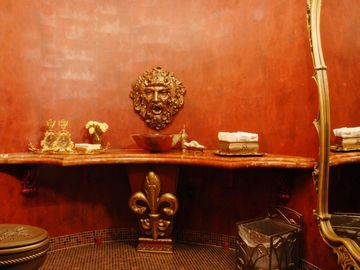 Amazing Powder Room with bronze toilet!