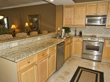 Granite Counter Tops, Travertine Floor Tile