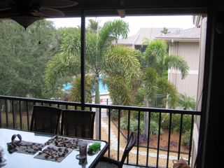 Sanibel Island condo photo - Lania looking to pool(A happy shell collector left their shells on the table)