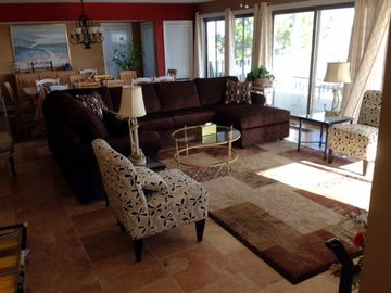 Gold Coast condo rental - Living Room area (dining area behind) with 4 sliding glass doors facing ocean.