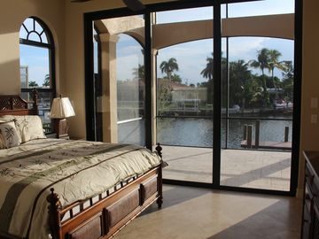Bedroom 2 - first floor - slider to lanai with saltwater pool & spa - TVs in all