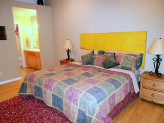 Moab townhome photo - Comfortable bedding for a good nights rest. Master has access to outside patio.