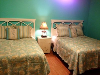 This cheerful bedroom has two queen beds, two closets, a balcony & full bath.