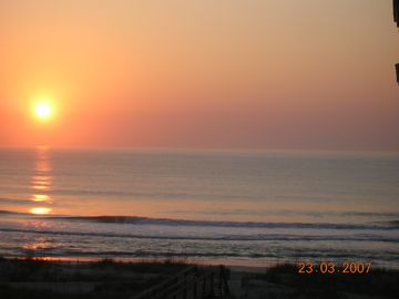 See a beautiful sunrise from inside or outside your vacation condo.