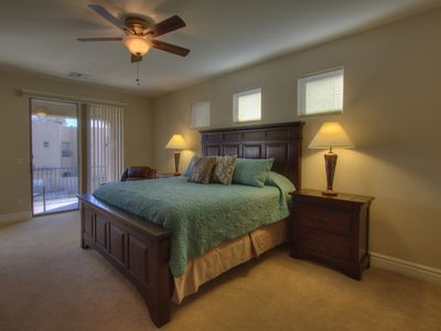 1st Master bedroom that overlooks heated pool. Private balcony with mtn views.