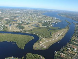 Port St. Lucie house photo - Arial of the Development, located along the St Lucie River, Ocean access 20 min.