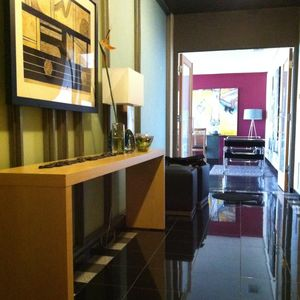 Private entry lobby with polished black granite floor opens to living room.