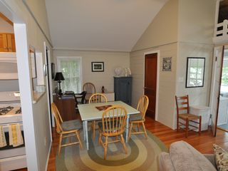 Unity cottage photo - Dining room and desk area, with cathedral ceiling