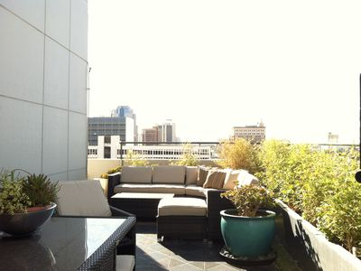 Spacious fully furnished private terrace overlooking downtown Long Beach skyline