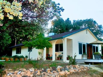 Mariposa house rental - This modern-styled house provides complete comfort, and overlooks private land.