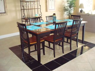 Ocean Reef condo photo - New inlaid tile flooring. Seating for 6 at table; 4 more at breakfast bar