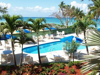 Grand Cayman condo photo - Refurbished pool with new pool furniture