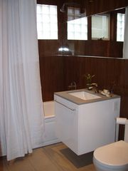 Guilford cottage photo - Designer Bathroom - storage cabinets on opposite wall