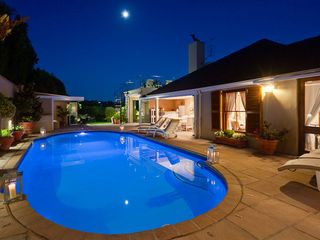 Constantia villa photo - Hetaed pool at night with full moon