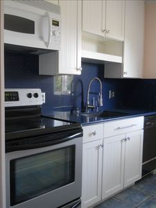 Brand new kitchen that includes ice maker and dishwasher.