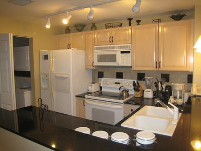 The kitchen is fully stocked and has a dishwasher & washer/dryer.