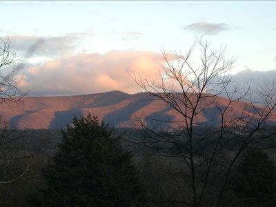 The sun sets on the Blue Ridge Mtns and sets them aglow with color.