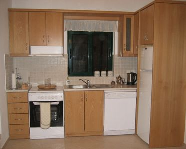 Almirida villa rental - Kitchen plus additional cupboards under stairs
