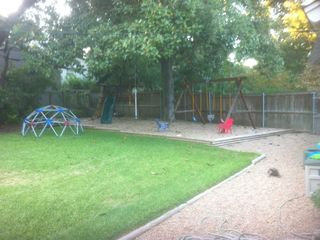 Austin house photo - Backyard swingset and playscape for kids